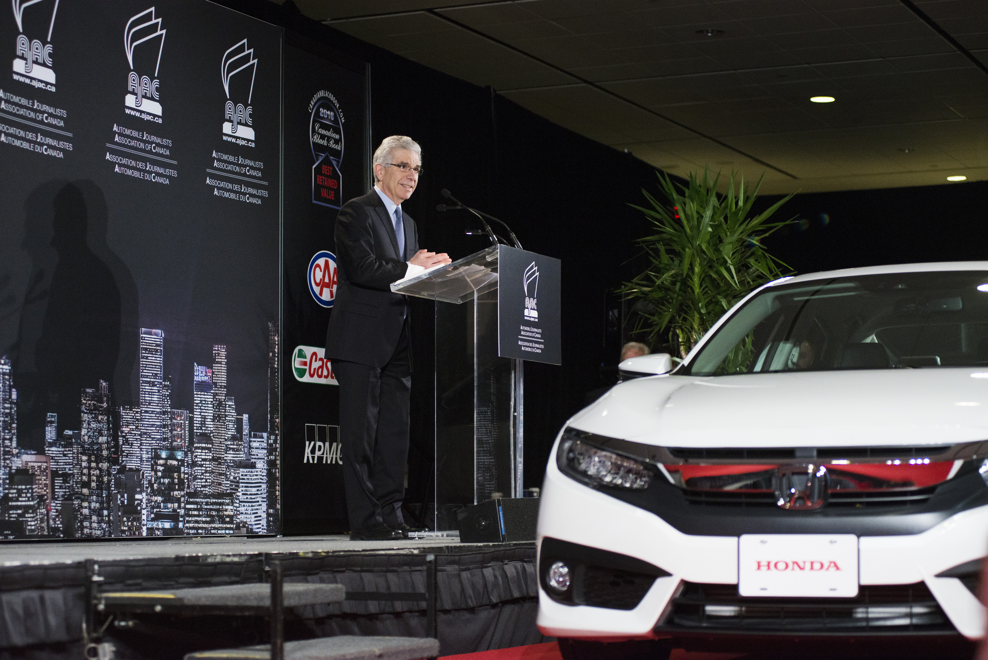 Honda President and CEO Jerry Chenkin accepting the 2016 Canadian Car of the Year (CCOTY) Award for the Honda Civic.  (Photos By: Michelle Siu)