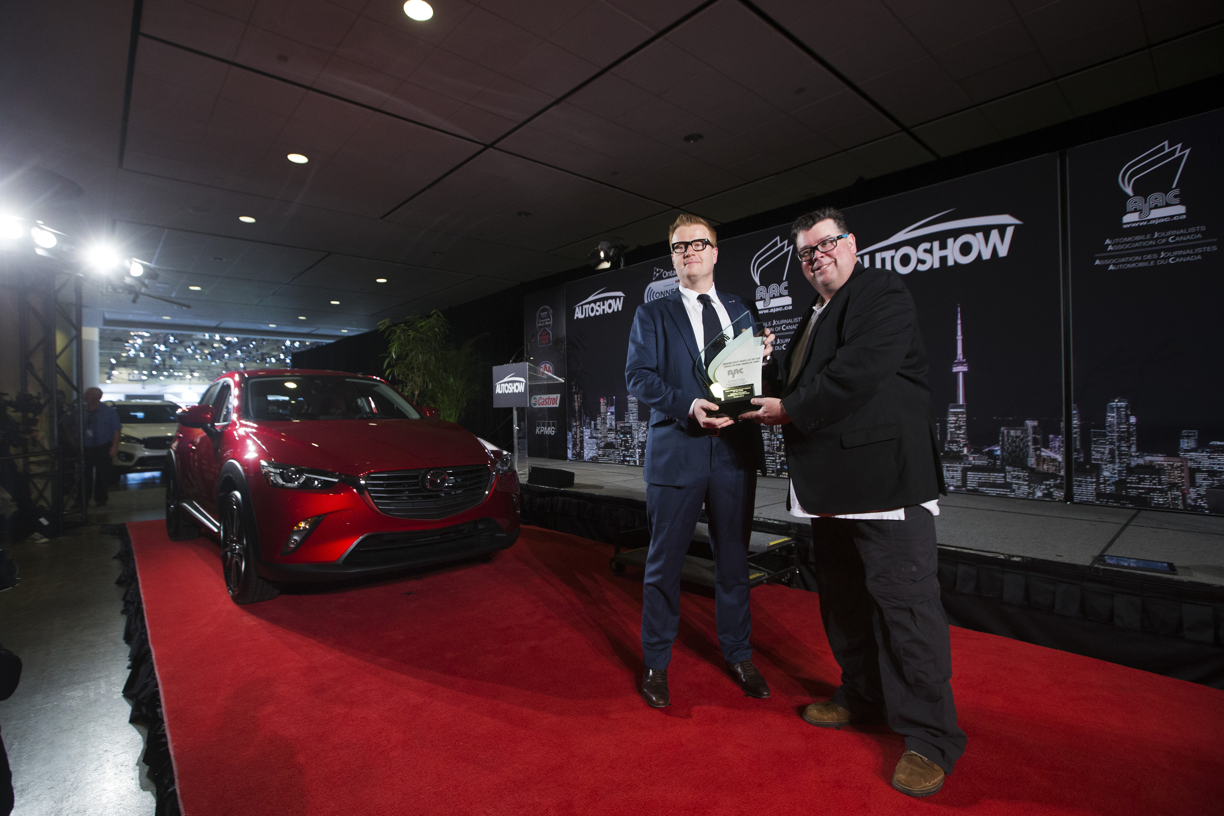 Vincent Reboul, Marketing Director at Mazda Canada Inc.left, poses for a photo with Gary Grant CCOTY Co-Chair, right, after the Mazda CX-3 was declared utility vehicle was declared the 2016 Canadian Utility of the Year by the Automobile Journalists Association of Canada (AJAC).  (Photos By: Michelle Siu)
