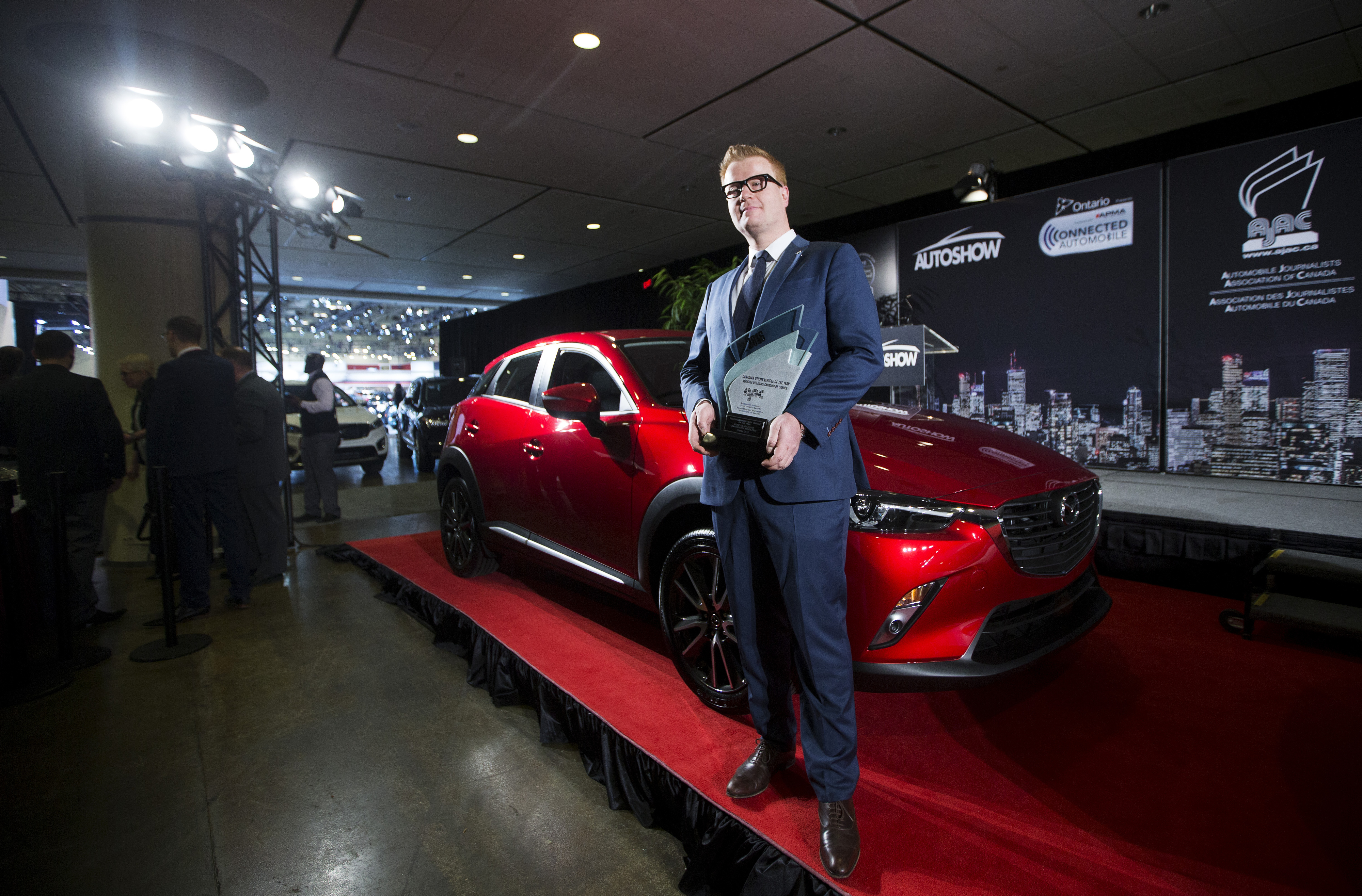 Vincent Reboul, Marketing Director at Mazda Canada Inc.left, poses for a photo with the Mazda CX-3 claimed top honours when the utility vehicle was declared the 2016 Canadian Utility of the Year by the Automobile Journalists Association of Canada (AJAC).  (Photos By: Michelle Siu)