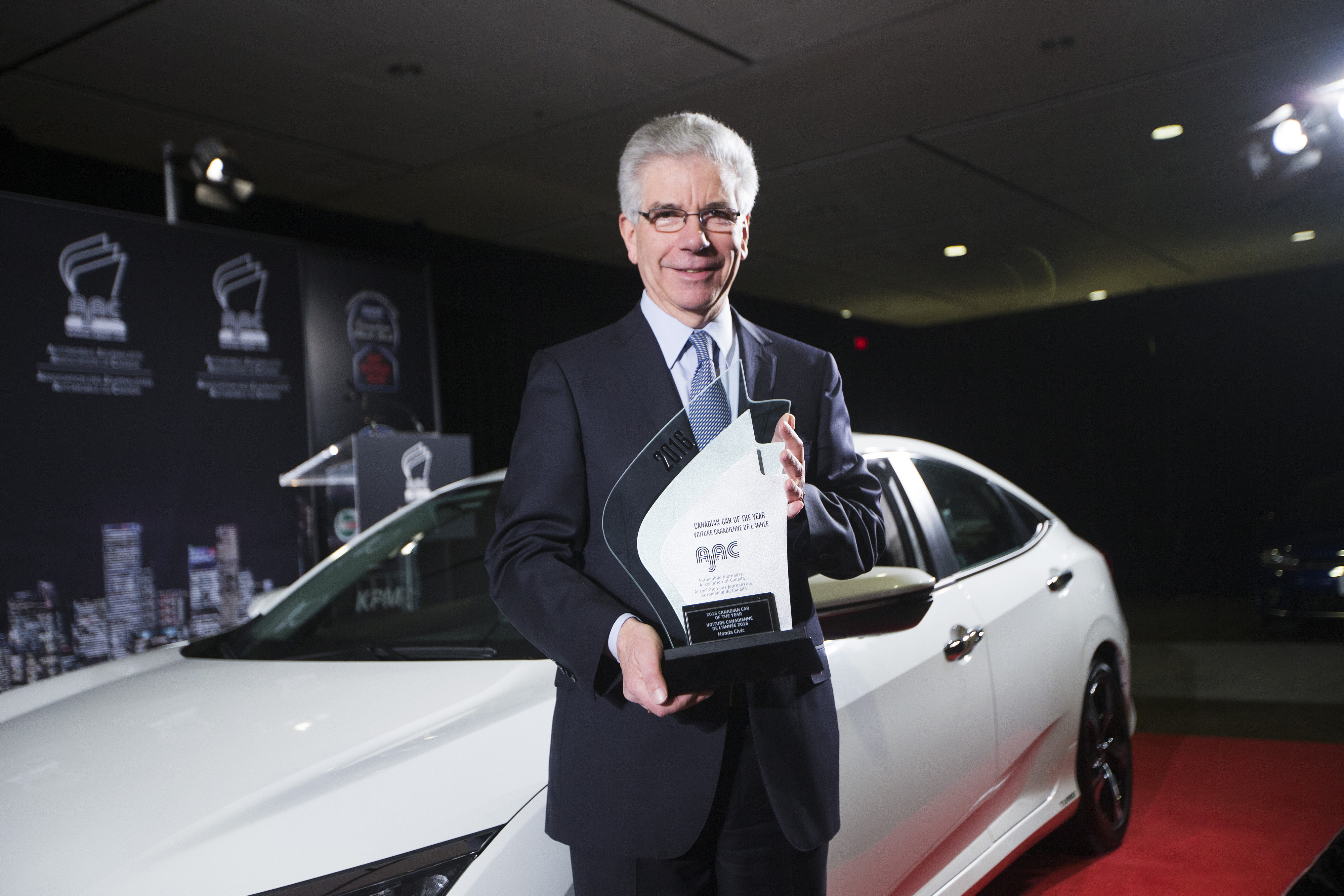 Honda President and CEO Jerry Chenkin with the Honda Civic which claimed top honours as the 2016 Canadian Car of the Year (CCOTY).  (Photos By: Michelle Siu)