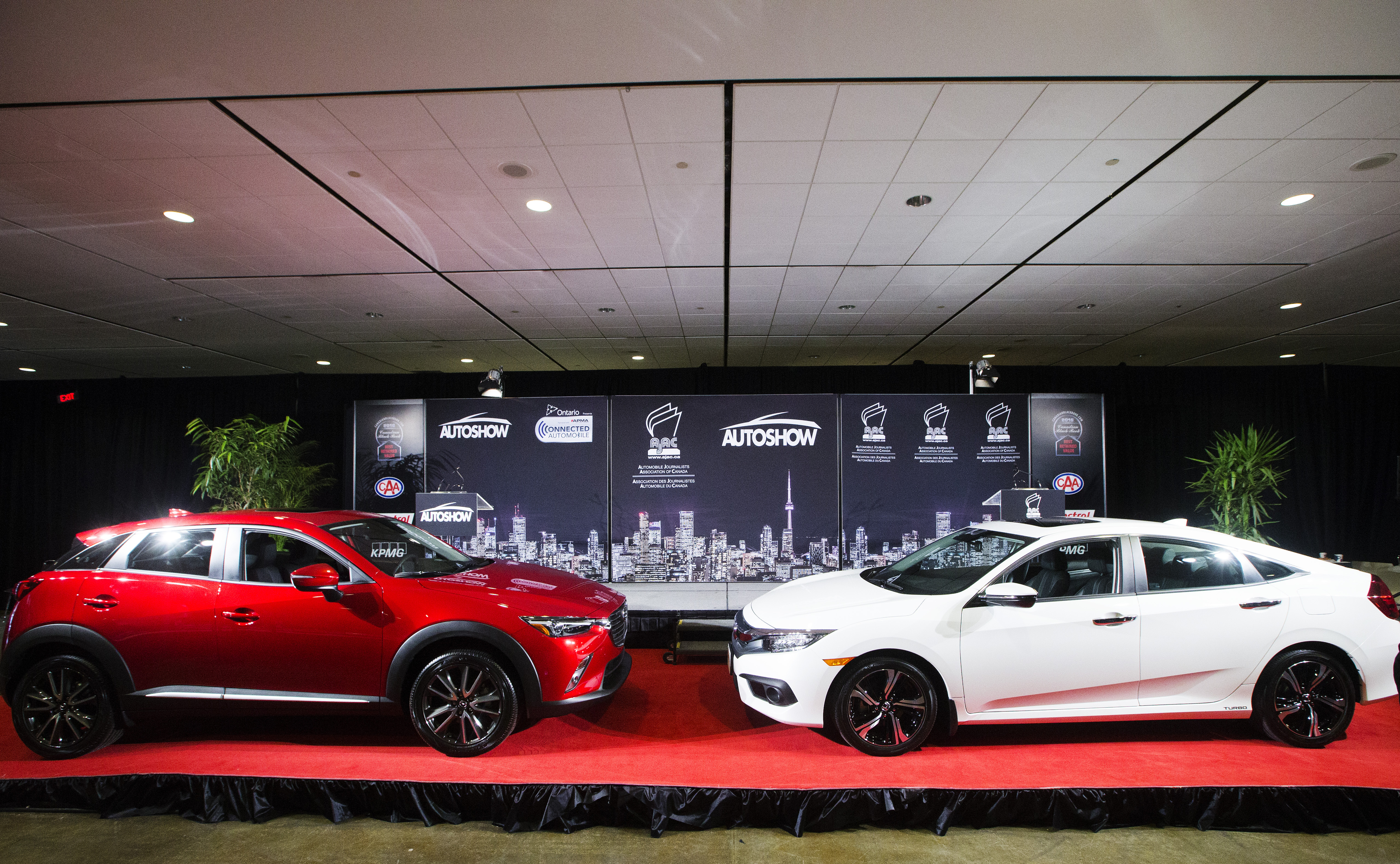Mazda CX-3 which was declared the 2016 Canadian Utility of the Year (left) and Honda Civic which was declared 2016 Canadian Car of the Year (right).  (Photos By:Michelle Siu)